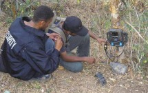 Walid and Murad setting a Reconyx trail camera